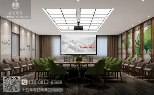 会议室里的灰墙搭配着浅绿的家具,使整个空间显得开阔而鲜亮。