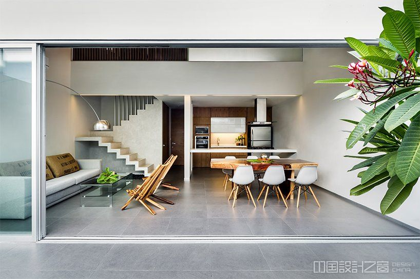 warm architects applies tropical wood in 'ciruelo 7' house in cancún, mexico